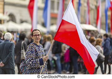 Woman holding a flag of Poland. - Woman on the street...