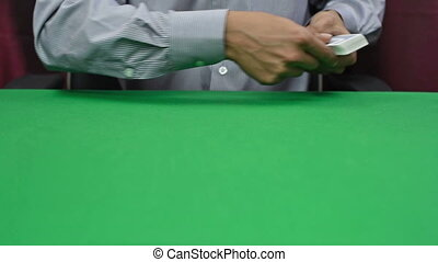 dealer deals the cards - dealer dealing cards by tossing...