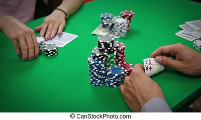 player bets - poker player with playing cards and chips at...