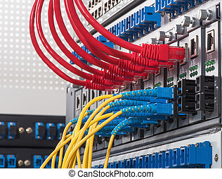 Fiber Optic cables connected to an optic ports and UTP...