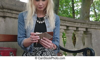 attractive blonde texting sitting
