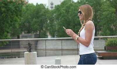Woman Taking A Selfie - Young woman stopping to take a...