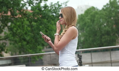 Young Woman Taking Selfie - Attractive young woman stopping...
