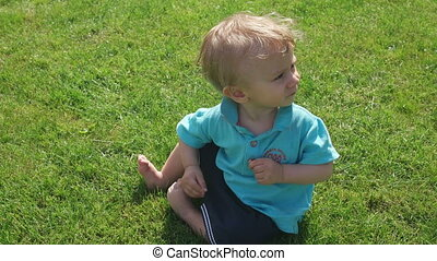 baby boy having fun playing with the bowl on the grass