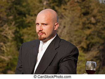 Groom With a Glass of Red Wine