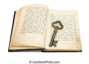 key placed on vintage bible - key placed on an 18st century...