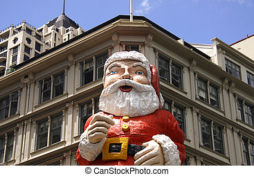 photo of a Giant Santa Claus on building in downtown,...