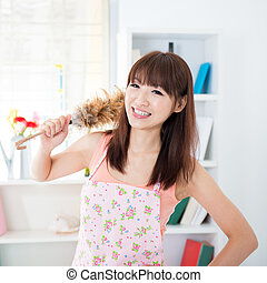 Housekeeping - Happy Asian housewife with apron...