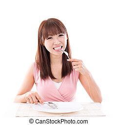 Dining concept, woman eating with empty plate