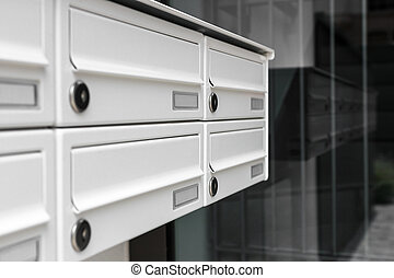 Mailboxes, with a modern design, positioned at the entrance...