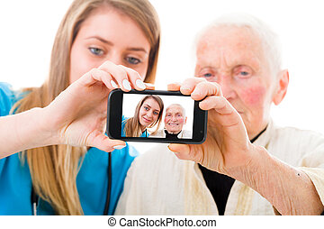 Senior patient and young doctor self portrait - Young doctor...