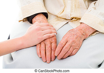 Family support concept - Supporting hands for senior woman.