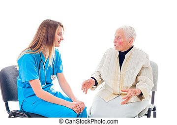 How can I help you - Doctor and elderly patient sitting on...