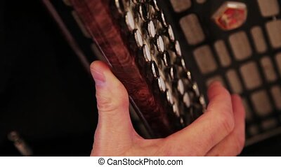 An accordionist plays a melody