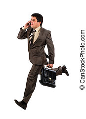 Business man running with a briefcase and speaking by phone,...