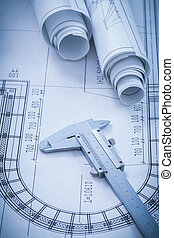 Construction plans metal vernier caliper on blueprint...