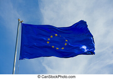 european union flag on a pole against blue sky