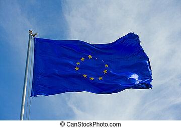 european union flag on a pole against blue sky