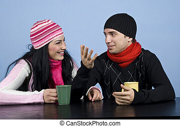 Couple having a funny conversation - Young couple sitting at...