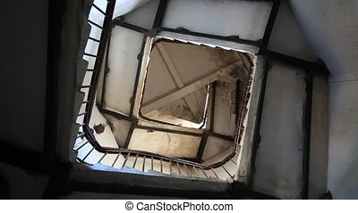 Upside view of spiral stairway case in lighthouse HD...