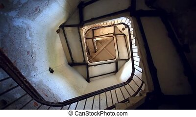 Upside view of spiral stairway case in lighthouse. HD....