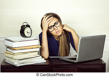 Young businesswoman working - Young businesswoman sitting at...