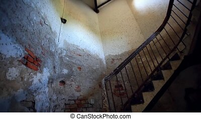 Dark spiral staircase with window into a lighthouse. Walking...