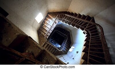 Dark spiral staircase with window into a lighthouse. HD....