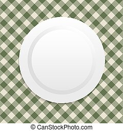 white plate on green tablecloth