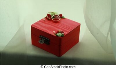 Beautiful wedding rings on the red box