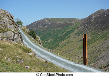 Honister Quarry Road - Road track with rusting post at...