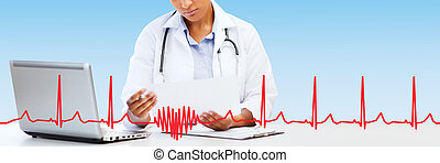 female doctor with laptop pc looking at paper - healthcare,...