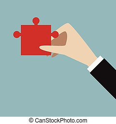 Hand with red puzzle