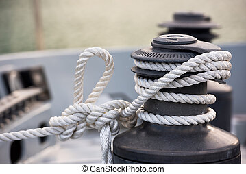 Winch and rope, yacht detail. Close up horizontal shot