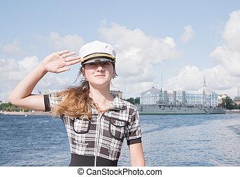 female tourist against Aurora cruiser museum,...