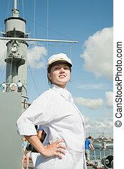 female tourist against Cruiser Aurora from StPetersburg