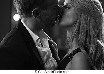Man and woman kissing - Portrait of man and woman in love...