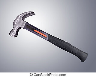 Hammer - Claw hammer with rubber handle isolated on gray...