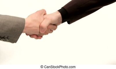 Fix A Handshake Deal - Two men in suits shake hands as a...