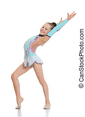 Girl gymnast doing exercises smiles