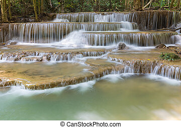 Blue stream waterfall - Deep forest blue stream waterfall in...