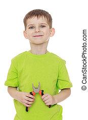 Little boy green t-shirt holding a pair of pliers - Little...
