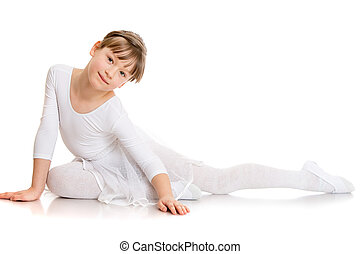 Beautiful girl contortionist in a tracksuit