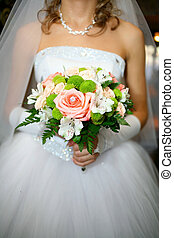 wedding bouquet - The bride keeps her wedding bouquet,...
