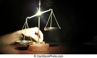 Man Placing Weights on Golden Balance Scales Standing On...