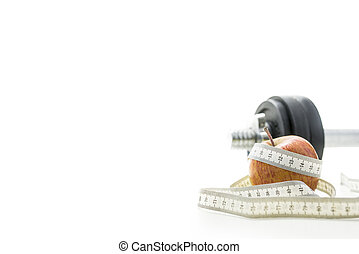 Close up of apple, measuring tape and dumbell - Close up of...