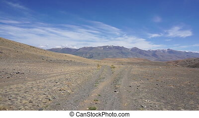 driving on a dirt road in the mountains