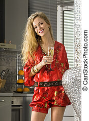 happy blonde woman in the kitchen
