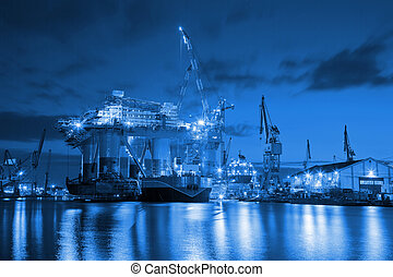 Shipyard - Oil Rig at night in Shipyard - industry concept.