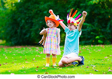 Kids playing in Halloween costumes - Kids in cowboy and...